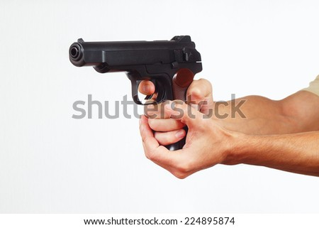 Hands with handgun on a white background - stock photo