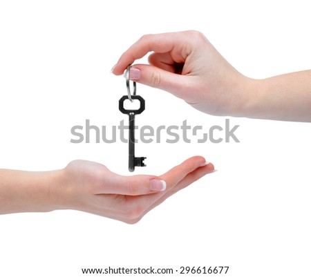 Hands with key isolated on white background