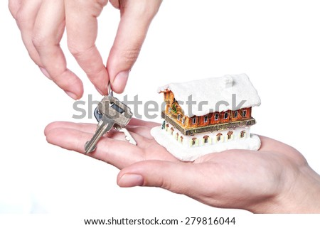 Hands with keys and house on white background - stock photo