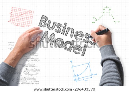 hands with marker writing business model - stock photo