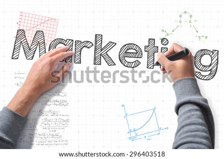 hands with marker writing marketing