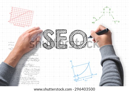 hands with marker writing SEO - stock photo