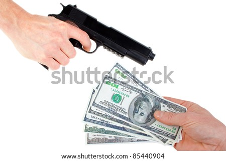 Hands with money and handgun, isolated on white.