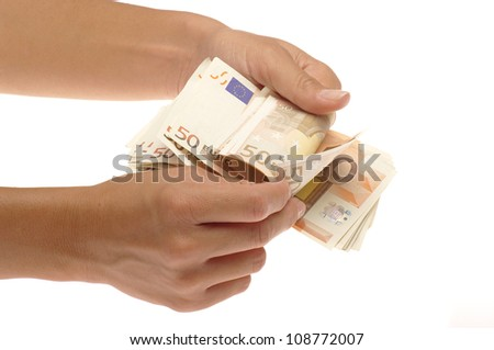 hands with money on the white background