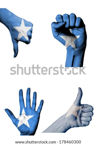 hands with multiple gestures (open palm, closed fist, thumbs up and down) with Somalia flag painted isolated on white