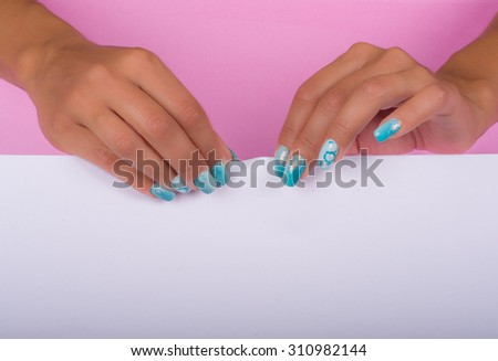 hands with painted nails that hold white sheet