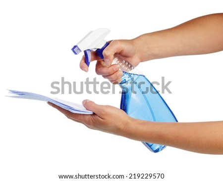 Hands with paper and Glass cleaner with blue fluid