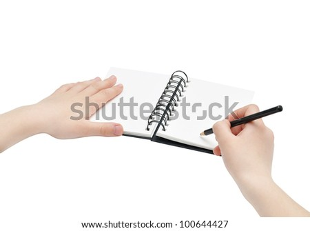 Hands with pencil and book note, empty pages, low angle