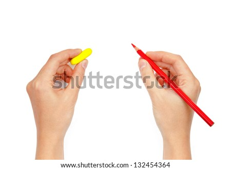 hands with pencil and eraser