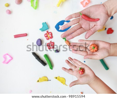 hands with plasticine