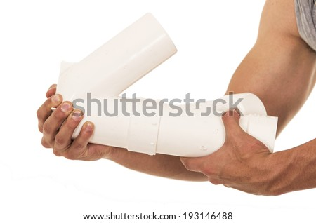 hands with plumbing pipes on a white background - stock photo
