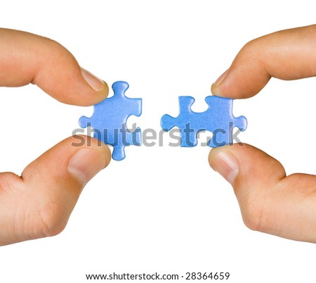 Hands with puzzle isolated on white background