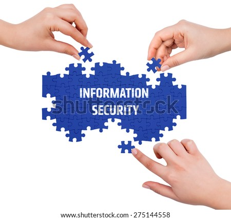 Hands with puzzle making INFORMATION SECURITY word  isolated on white  - stock photo