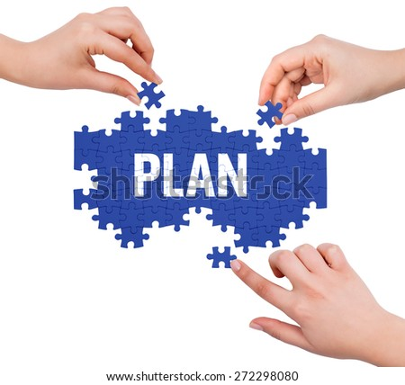 Hands with puzzle making PLAN word  isolated on white  - stock photo