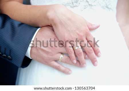 Hands with rings of a wedding couple - stock photo