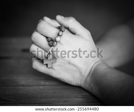 hands with rosary beads, prayer