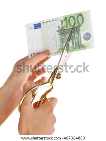 Hands with scissors cutting Euro banknote, isolated on white - stock photo