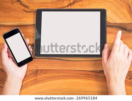 Hands with smartphone and tablet - stock photo