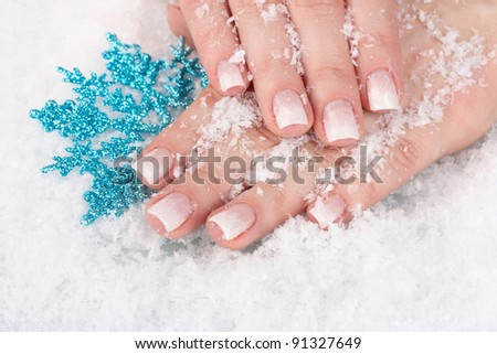 hands with snow and snowflake closeup - stock photo