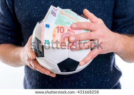 hands with soccer ball and money - euros - stock photo