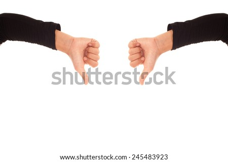 Hands with thumb down isolated on white background. KO sign by woman