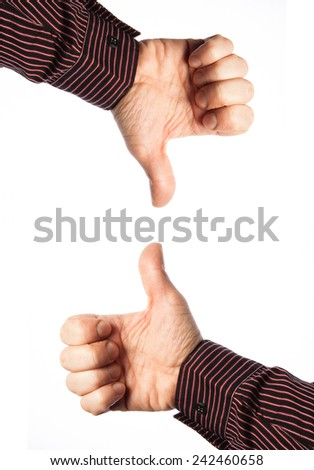 hands with thumb up  and down on white background - stock photo