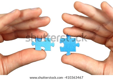 Hands with two puzzles