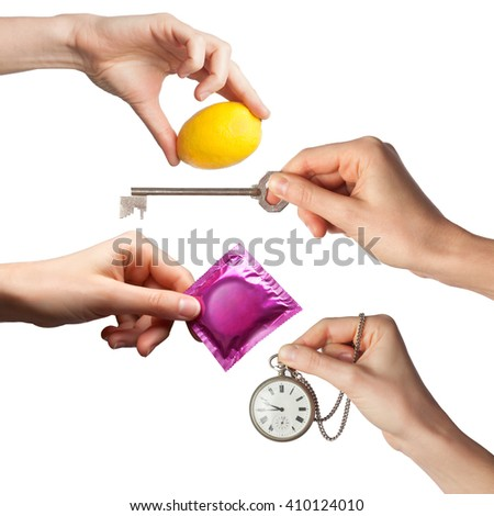 hands with various objects on a white background - stock photo