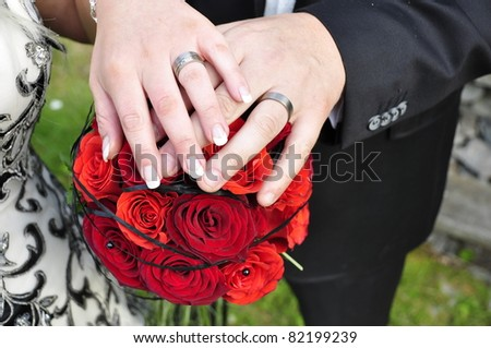 Hands with wedding rings and flowers