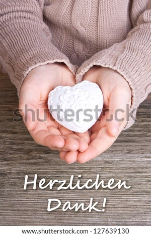 Hands with white heart and lettering thanks/thanks/heart - stock photo