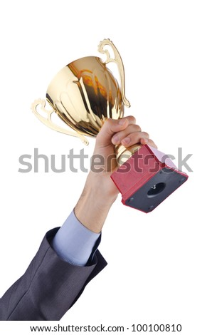 Hands with winners cup on white - stock photo