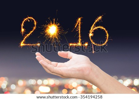 hands with writing sparklers firework with bokeh background - stock photo
