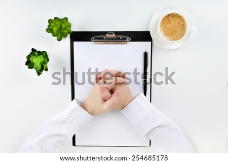 Hands working in the office with documents, on white background - stock photo