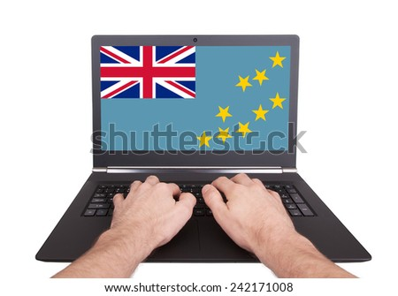 Hands working on laptop showing on the screen the flag of Tuvalu