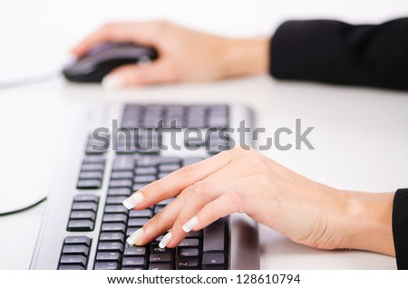 Hands working on the keyboard - stock photo