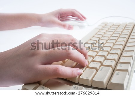 Hands working on the keyboard isolated on white background - stock photo