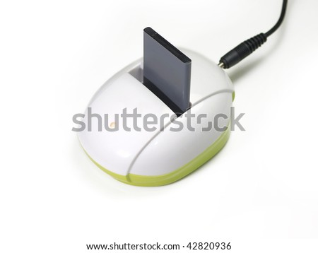 Handset battery on charger - stock photo