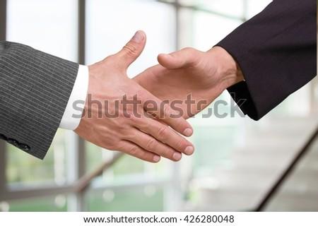 Handshake. - stock photo
