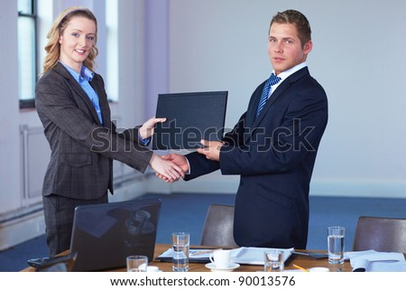 handshake after contract signing, business office shoot - stock photo