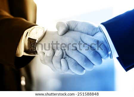 Handshake and a city. Abstract business concept. - stock photo