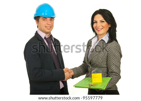 Handshake architect with buyer woman holding folder and miniature house with keys isolated on white background