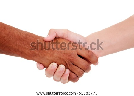 handshake, between a white and a black young man, - stock photo