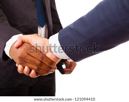 Handshake between african and a caucasian business man, isolated on white - stock photo