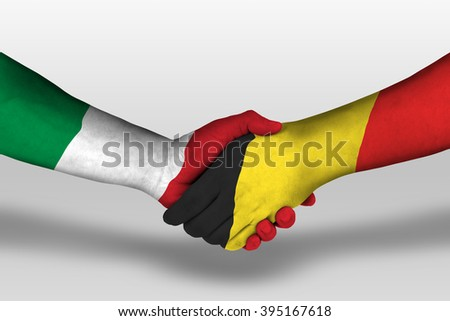 Handshake between belgium and italy flags painted on hands, illustration with clipping path. - stock photo