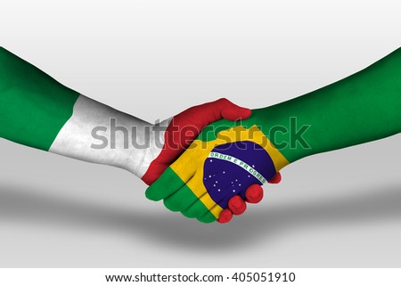 Handshake between brazil and italy flags painted on hands, illustration with clipping path. - stock photo