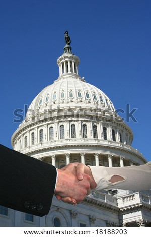 handshake between business people and US Capitol building