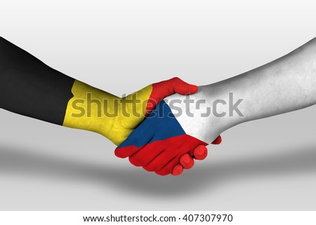 Handshake between czech republic and belgium flags painted on hands, illustration with clipping path.
