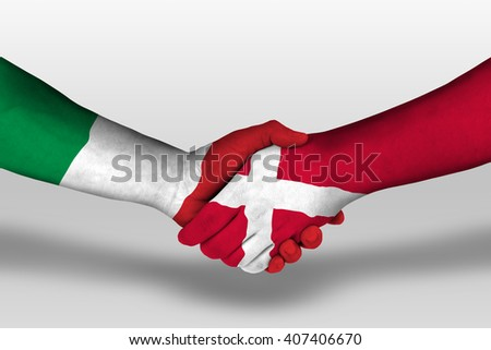 Handshake between denmark and italy flags painted on hands, illustration with clipping path. - stock photo