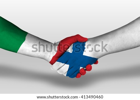 Handshake between finland and italy flags painted on hands, illustration with clipping path. - stock photo