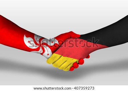 Handshake between germany and hong kong flags painted on hands, illustration with clipping path.